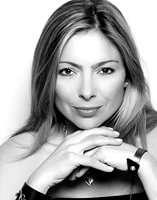 Anna Griffin editor in chief Coco Eco magazine in Andrea Gutierrez bracelet